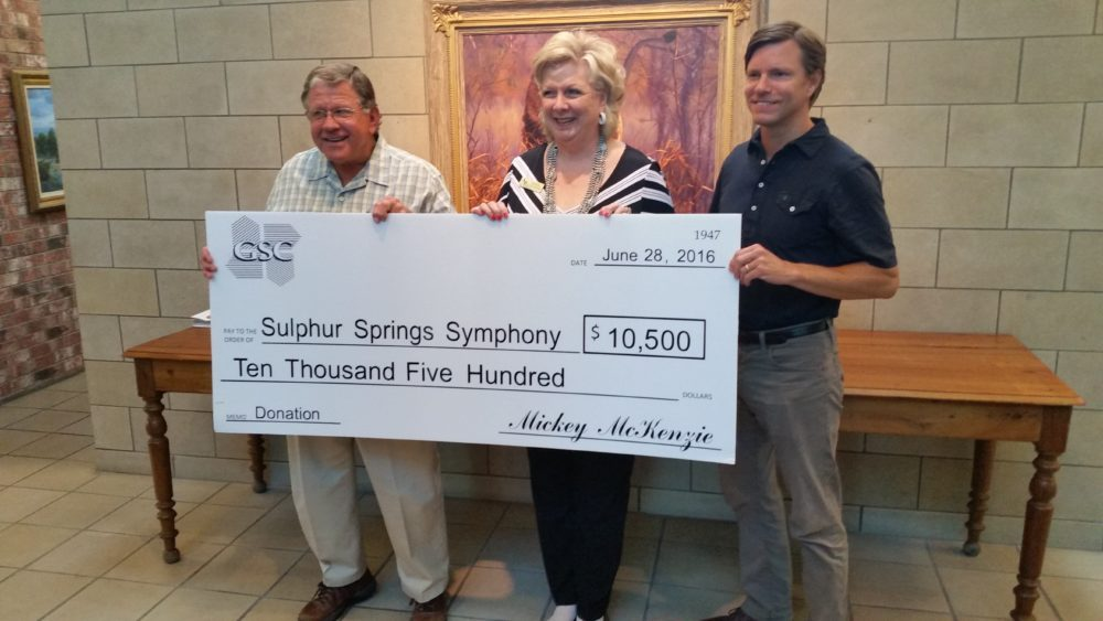 (Left to Right) Mickey McKenzie, Chairman of the Board, Linda Galligher, President, Sulphur Springs Symphony League, Ryan McKenzie, Chief Operating Officer
