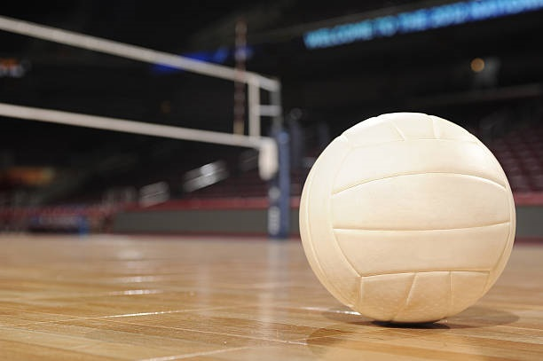 Volleyball on Wood Floor with net